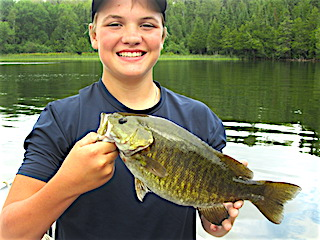 Niko's Smile Tells The Story Fishing for BIG Smallmouth Bass at Fireside Lodge